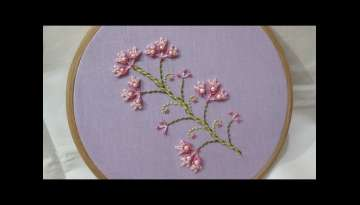 Hand embroidery of a flower twig with Double Buttonhole Stitch and Bullion Stitch